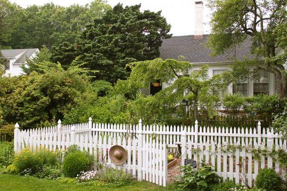 white picket fence around a raised bed garden. Love!