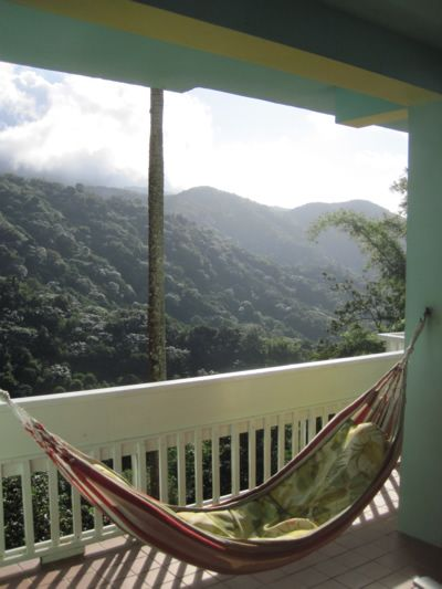 El Yunque Rain Forest, Puerto Rico. Casa Cubuy Ecolodge porch in the clouds.