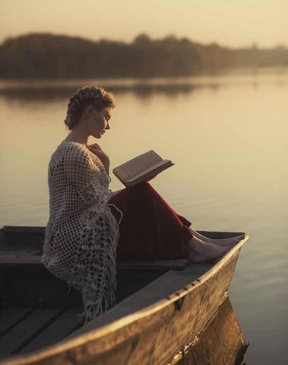 """books0977: """" Reading on lake. Life's simple pleasures. Photo by David Dubnitskiy. """"The lake of my mind, unbroken by oars, heaves placidly and soon sinks into an oily somnolence. That will be useful.""""..."""