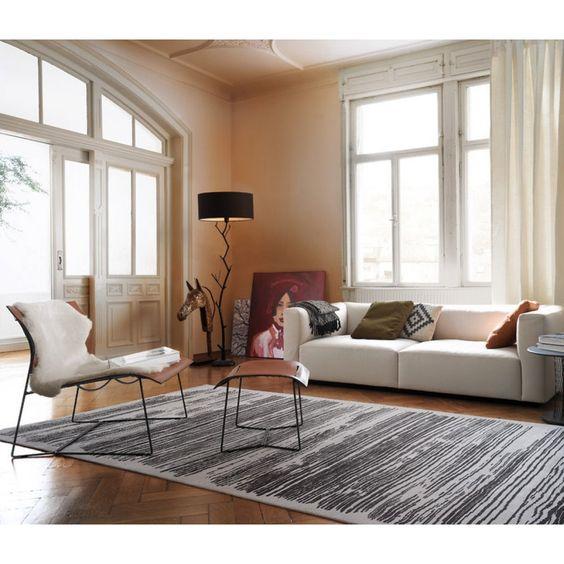 http://www.einrichten-design.de/de/cuoio-lounge-hocker-sessel-von-walter-knoll.html