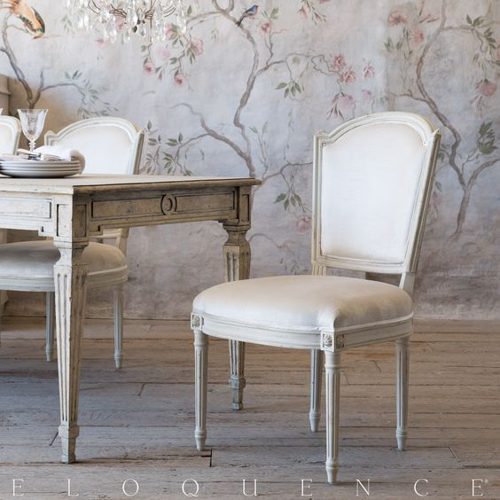 Eloquence® Flins Dining Chair clean and classic Scandinavian shape with delicate carved rosettes. • 39H x 21W x 26D • Seat Height: 18 • Antique White Finish • Ivory Velvet Upholstery