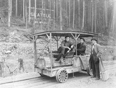Men with sign at Masonry Dam, 1914