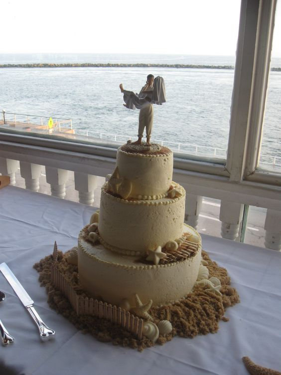 Our Disc Jockey Service provided the entertainment for an amazing wedding at Harrison's Harbor Watch Restaurant in Ocean City, MD when we saw this beautiful cake. To get more cake ideas you can visit our website at www.SteveMoody.com