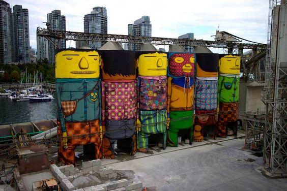 Ô Canada, Terre de nos aïeux :) Après avoir repeint un Boeing 737 il y a quelques mois, le duo de street artists brésiliens Os Gêmeos vient de s'attaquer aux silos industriels de Vancouver, à l'occasion de la Vancouver Biennale. Une installation monumentale pour laquelle les deux artistes ont recouvert plus de 2000m² avec leurs personnages étranges et colorés.