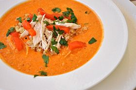 """By using flavorful ingredients, like roasted red bell peppers and white bean hummus, this soup tastes like you slaved over it all afternoon– but really takes less than 20 minutes to throw together. This recipe is a great way to fit some quinoa into your diet. Quinoa is a protein-packed seed that is considered a """"super food""""."""