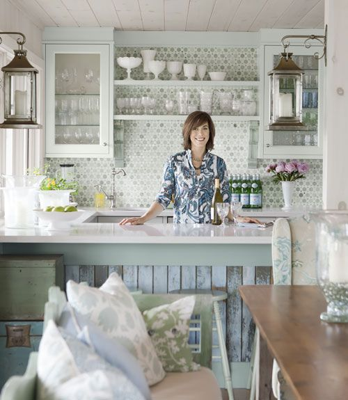 Cozy cottage kitchen by Sarah Richardson with vintage style cabinets, tile backsplash, and lanterns #kitchen #cottagestyle #aqua #mosaictile #backsplash