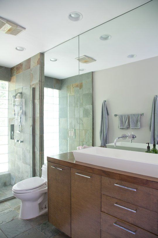 love sink and wall mount faucet through mirror.  nice. frameless shower cool too.