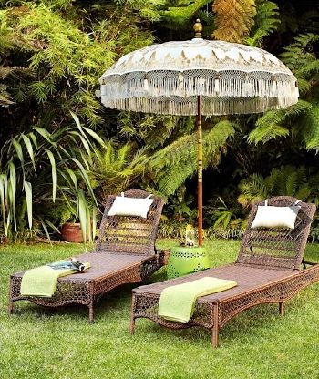 Outdoor chaise and umbrella at british colonial west in - Chaise style colonial ...