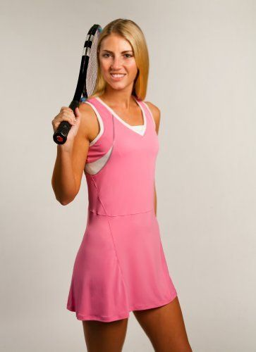 Performance Wear Tennis Dress in Pretty in Pink by Cruise Control. $45.00. Dress for success and cruise on the court with Cruise Control performance wear dresses in Pretty in Pink. Embroidered trademark Cruise Control logo design on back of dress, contains a racer back style, built-in bra support, with light-weight high quality performance wear fabric that flatters every female tennis players' curves. Look Good, Play Better! *