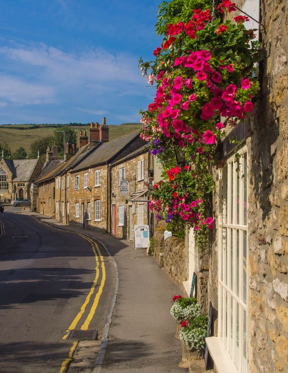 Flowers adorn a house in Abbotsbury, Dorset_ England