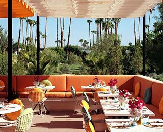 lounging in a classy Mid Century modern hotel patio in Palm Springs, California