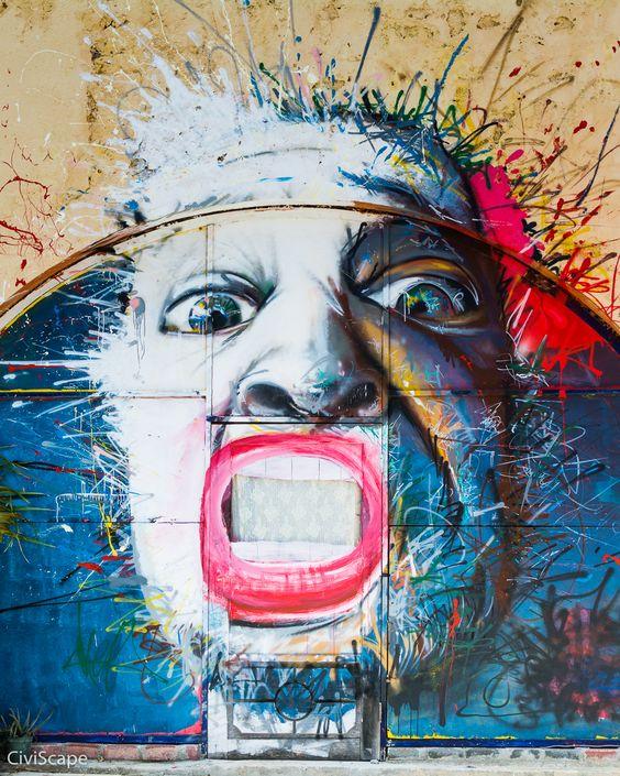 Graffiti Face Bursting from a Wall in Curaçao