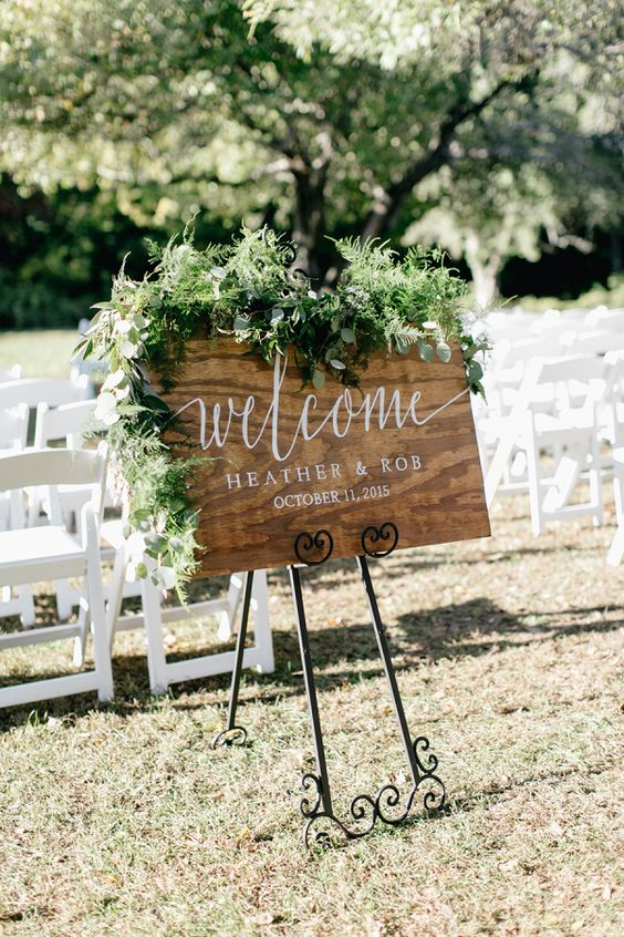 Rustic welcome wedding sign: http://www.stylemepretty.com/pennsylvania-weddings/2015/11/27/elegant-outdoor-fall-wedding-with-an-apple-orchard-ceremony/ | Photography: Emily Wren - http://emilywrenweddings.com/