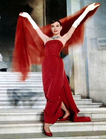"Audrey Heburn.  1957 Film:  ""Funny Face""  This dress only graced the screen for a fleeting moment but the impact left it's mark.  It is one of the main images for the film and still remains a fashion icon .    Designer: Givenchy"