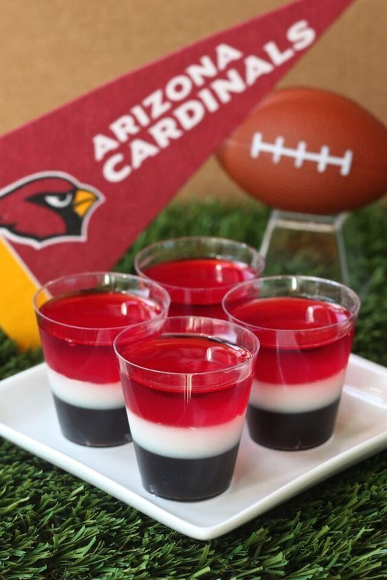 Arizona Cardinals Jell-O Shot (3 oz. box cherry Jell-O 4 envelopes Knox plain gelatin 3 cup vodka 1 cup milk 1/4 cup granulated sugar 3 1/2 Tbs grape Jell-O powder 3 1/2 Tbs lime Jell-O powder Black food coloring)