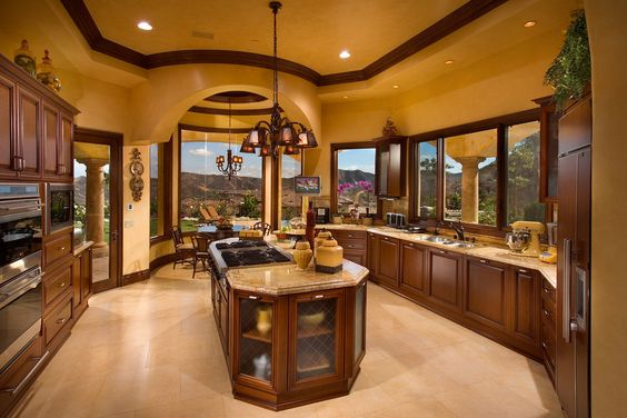 I love that all the places you stand at, like the sink and the stove has a great view with those windows.  The Breakfast Nook too!