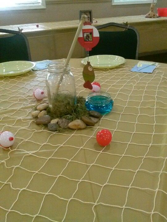 Fishing tables and centerpieces on pinterest for Fish net decoration ideas