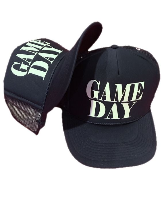 Show everyone you've got game with this GAME DAY retro snapback trucker hat in…