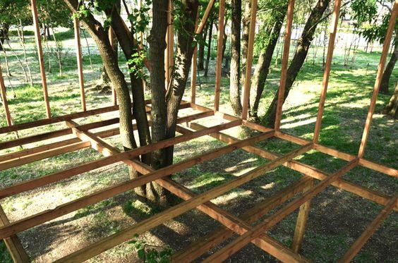 toshihiro oki erects tree wood folly in NY sculpture park