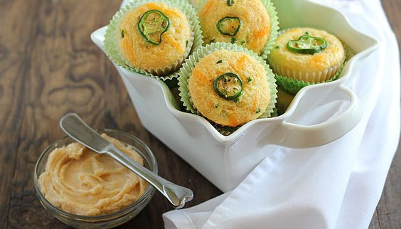 Cheddar jalapeno corn muffins prepared with shredded cheddar cheese and jalapenos served with chipotle honey butter.