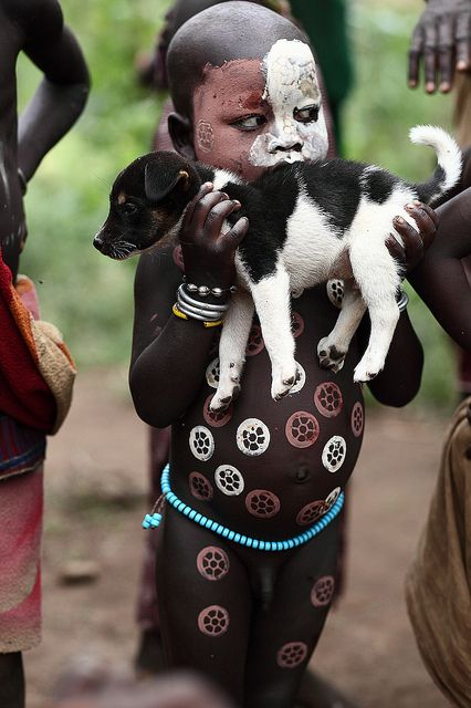 Africa |  Little Suri boy from West Omo River, Ethiopia.  Mum, oh please mum, can I have this puppy.....