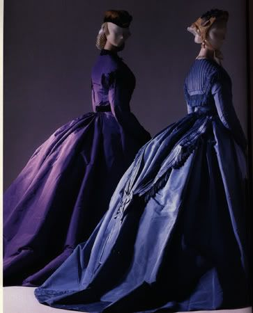 Two beautiful silk day or visiting dresses from 1865. From the Metropolitan Museum of Art.