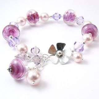 Pink handmade lampwork beads combined with swarovski crystals and pearls and a sterling silver clasp