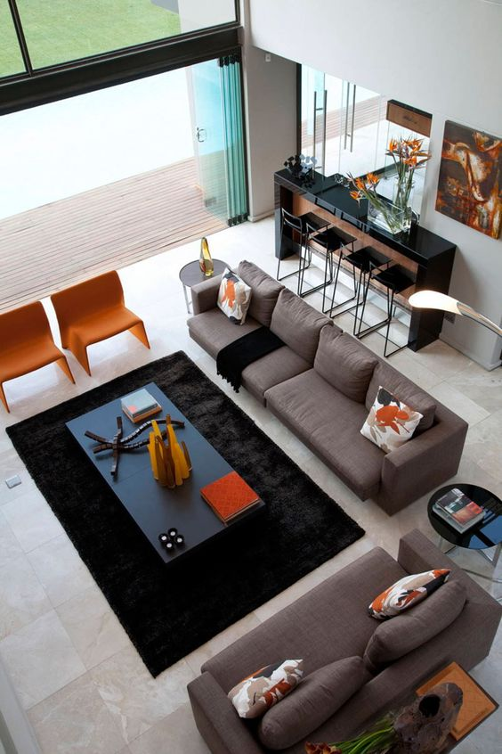 Get some interior design ideas by looking at 15 living room layouts from above // This living room shows how perfectly fitting together furniture, rugs, and accents, can make a space feel finished yet homey.