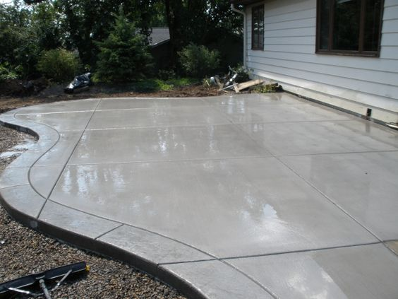 Concrete patio with stamped border deck patio for Cool concrete ideas