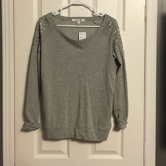 Grey F21 sweatshirt Grey sweatshirt from Forever 21 with embellishments on the shoulders. Lightweight. Size M. Forever 21 Tops Sweatshirts & Hoodies
