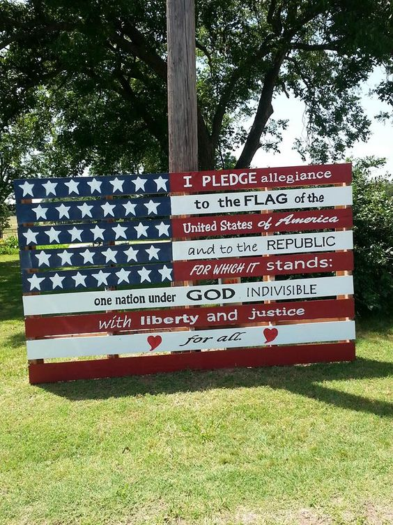 Painted the flag on an over sized pallet then added Pledge of Allegiance using different fonts.