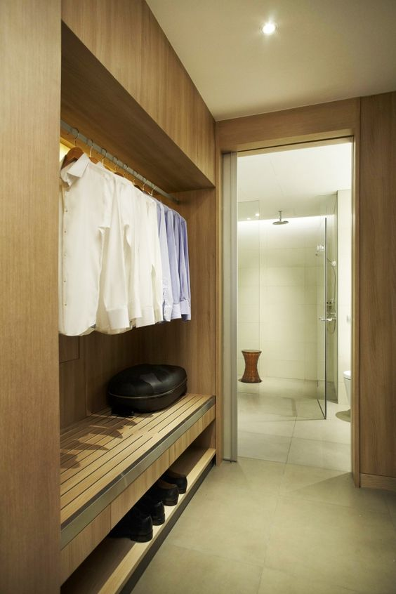 Walk in wardrobe two wardrobes on either side walkway for Bathroom walk in closet designs