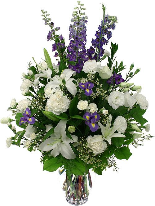 Blue hybrid delphinium, white lilies alstroemerias I'd add dahlias and iris: