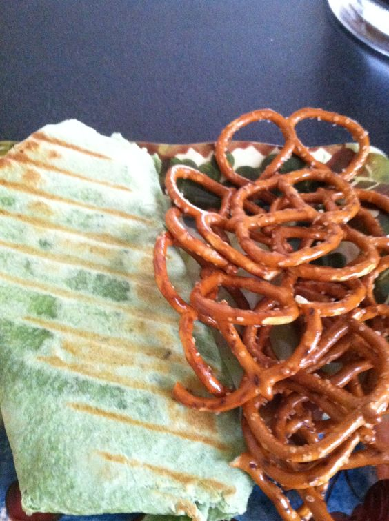 Spinach Wrap I threw on the Panini Griller with Pretzels for lunch. (Wrap stuffed with yellow/green bell peppers, red onion, low-fat mozzarella, and hummus)