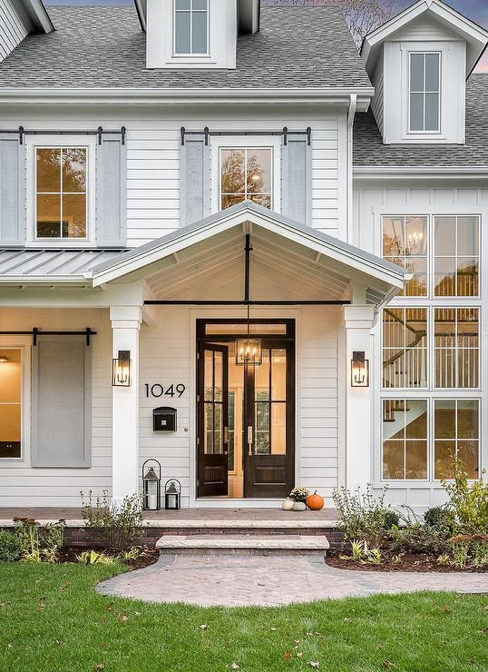 Modern Horizontal House Numbers Next To A Black Glass Panel Double Front Door Lit By Carriage Gla Brick Exterior House Modern Farmhouse Exterior House Exterior