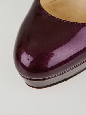 These chic and elegant Christian Louboutin Amethyst Metal Patent Leather Bianca Pumps are a great addition to any wardrobe! These platform pumps have a stiletto heel that measures approximately 5.5 inches and a 1.6 inch platform sole. They will give you the height and poise that every Louboutin woman desires. Soft rounded toe style with leather lined upper makes for a comfortable fit. Current retail price is $845.  Louboutin's trademark glossy red soles give an instant stamp of fashion…