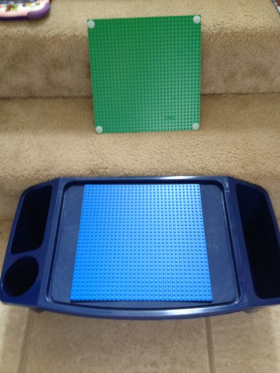 Kids tray and Lego base plates. Add velcro and voila! Cheap & easy ...