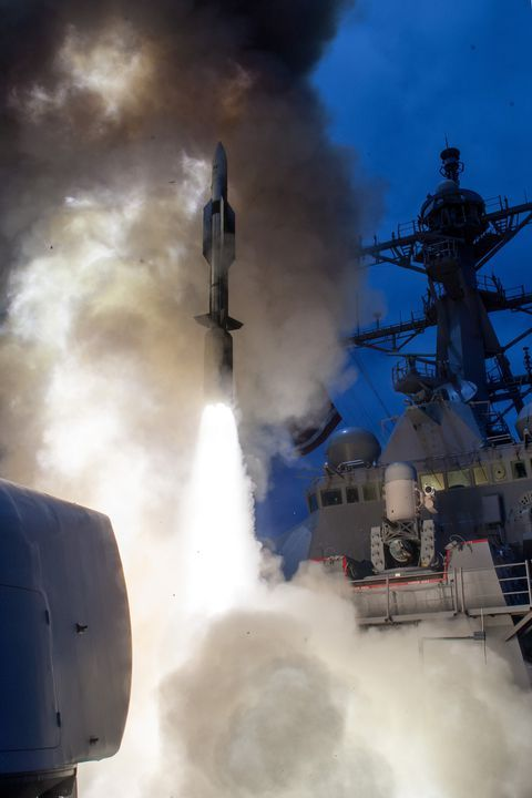 SM-6 missile rising from a vertical launch silo on the USS John Paul Jones. U.S. NAVY PHOTO.