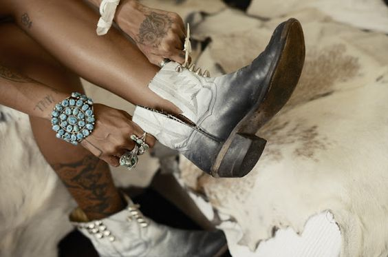 Chopped,spray-painted and studded cowboy boots. Tres chic mash-up.