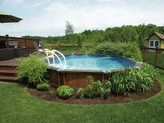 Come Arredare Un Giardino Con Piscina I Consigli Per Vivere A Pieno L Estate D Piscina Paesaggistica In Cortile Progettazione Di Cortili Decorazioni Piscina
