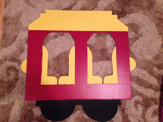 Daniel tiger trolley made out of cardboard from hobby lobby. Total cost was about $6 for cardboard and poster board. Small cost, big impact!