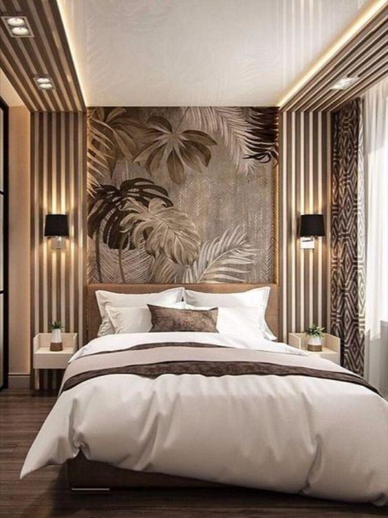prachtig behang met grote bladeren achter je bed
