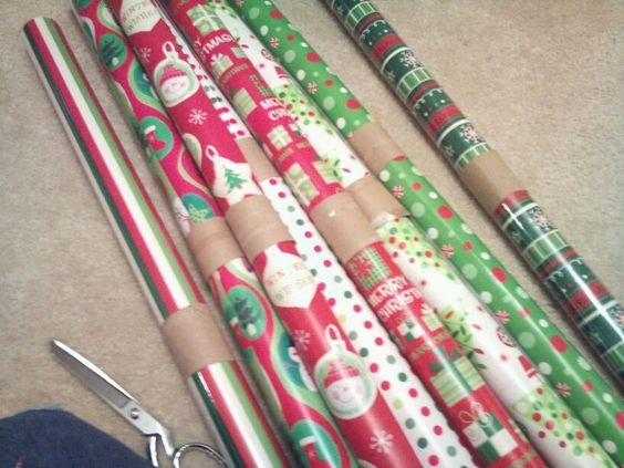 Toilet paper rolls to keep the wrapping paper from unraveling...so smart.