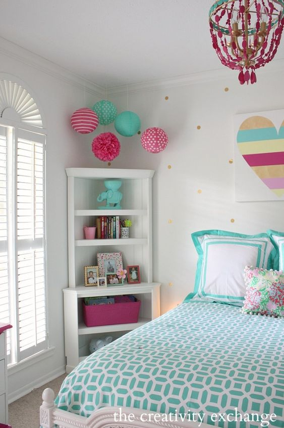 Hang paper party lanterns, just hammer a nail into the ceiling with the string tied to the nail - Bright and fun girl's room revamp project.  The Creativity Exchange
