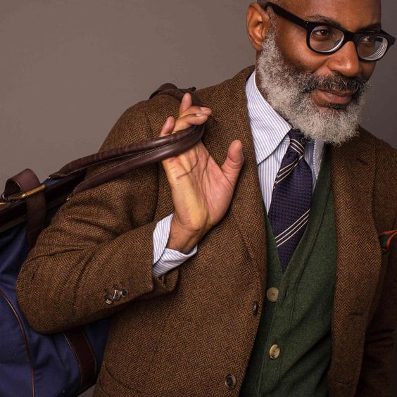 Close up on herringbone tweed, sleeveless Lambswool cardigan, Oxford button-down & Grenadine/Repp.  #drakes