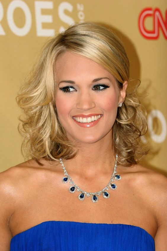 Carrie Underwoods elegant side parted hairstyle