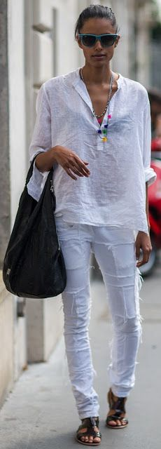 all white linen shirt, adorned with a coloured necklace and shabby jeans. perfect for late spring!