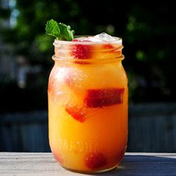 Sweet nectarines are blended then shaken with fizzy soda, iced vodka and sun-ripened raspberries.
