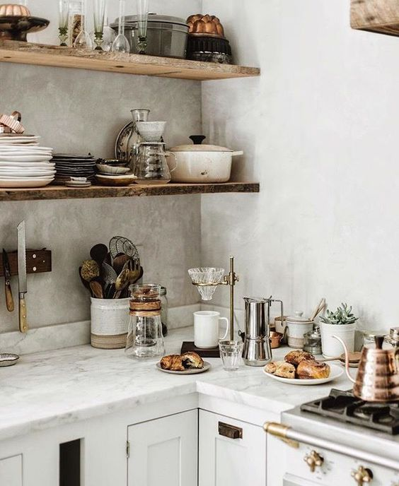 Inspiring white kitchen decorating ideas from Beth Kirby's glorious modern farmhouse kitchen. Rustic decor with wood shelves, marble countertops, and white painted cabinets. #kitchendecor #rusticdecor #shelves #modernfarmhouse #farmhousekitchen #bethkirby