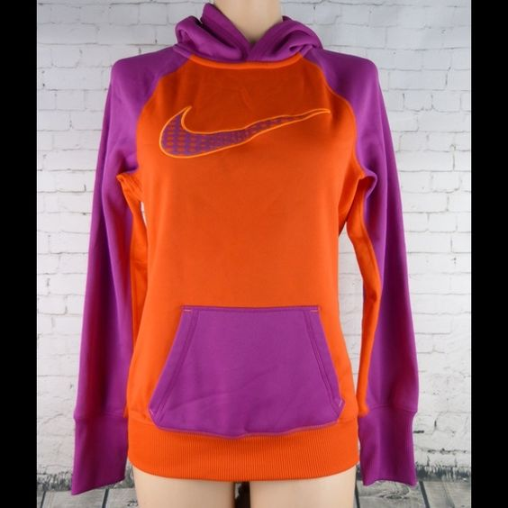 Nike Therma Fit Hooded Sweatshirt, Top. Size Small Brand new condition!!!!  Pink and orange.  100% polyester.  Measures 25 inches from shoulder to hem  Measures 18.5 inches side to side at the under arm.  Comes from a non-smoking environment Nike Tops Sweatshirts & Hoodies